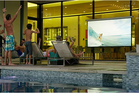 outdoor movie watching on a Screen Innovations Solo screen by the pool